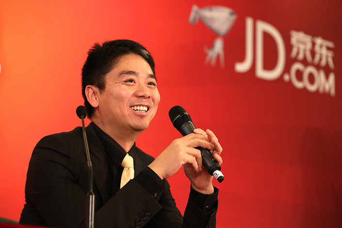E-commerce giant JD.com this week reported its first quarterly profit since its IPO in 2014. Above, JD.com CEO Richard Liu listens to a question during an interview in Beijing on Dec. 23, 2013. Photo: Visual China