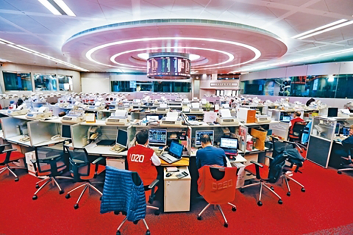 Hong Kong Exchanges and Clearing Ltd. plans to offer gold futures contracts denominated in the Chinese currency and in U.S. dollars starting in the third quarter. Above, floor brokers work at the Hong Kong Stock Exchange in Hong Kong. Photo: IC