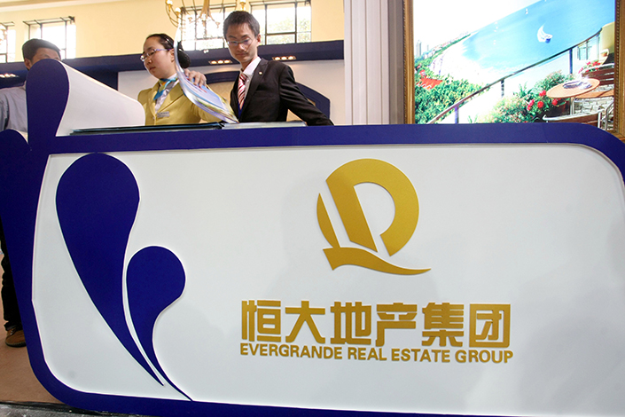 Nine people, four from property developer China Evergrande Group, have been detained on suspicion of faking identity documents for prospective homebuyers. Photo: IC