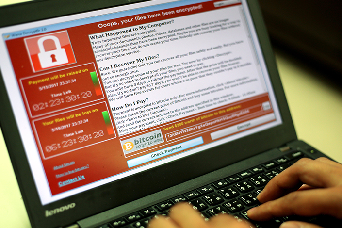 The WannaCry malware, which is wreaking havoc across China and the world, encrypts the victim's files and demands a ransom of about $300, which eventually doubles. If the ransom still isn't paid, the files are deleted. Photo: IC