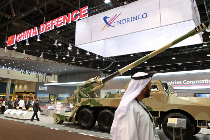 Saudi Aramco is expanding to China with plans to build a massive refinery and chemicals complex with state-owned defense conglomerate China North Industries Group Corp., also known as Norinco. Above, Norinco weapons are displayed at the International Defense Exhibition in Abu Dhabi, United Arab Emirates, in February 2011. Photo: Visual China