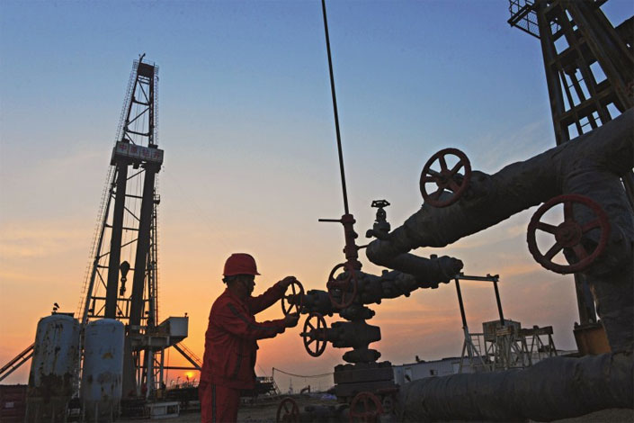 A China National Petroleum Corp. oil field is seen in Tangshan, Hebei province. China's three major oil companies recently announced plans to invest a combined 371 billion yuan this year.