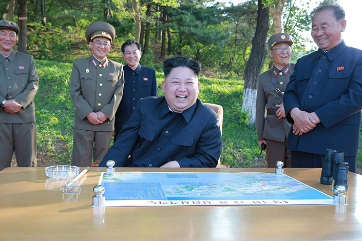 North Korean leader Kim Jong-un smiles in this photo the country says was taken after the latest missile test.