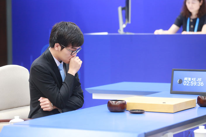 Ke Jie, the world's top Go player,  reflects during his match on Tuesday against AlphaGo, an artificial intelligence computer owned by Google. Photo: IC