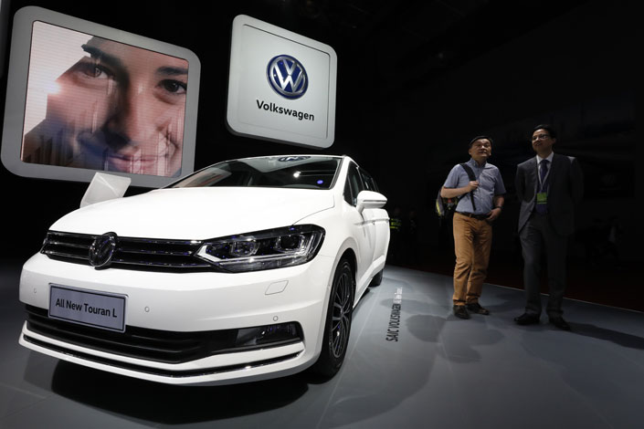 Visitors look at a Volkswagen display booth at the Auto Shanghai 2017 show at the National Exhibition and Convention Center in Shanghai, China, on April 19. Photo: IC
