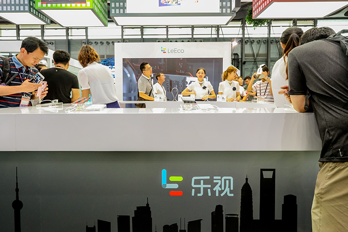 People visit the booth for LeEco during the 2016 Mobile World Congress (MWC) in Shanghai, China, on June 29, 2016. Photo: IC
