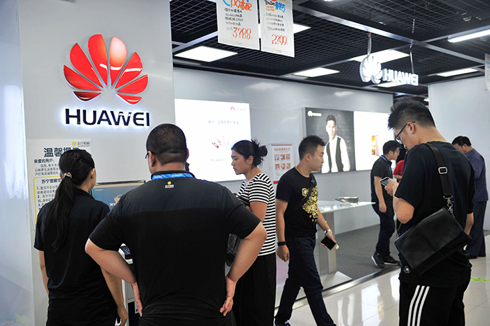 Customers visit a Huawei counter at a home appliance store in Qingdao. The telecoms giant is launching a second generation of portable PCs. Photo: IC