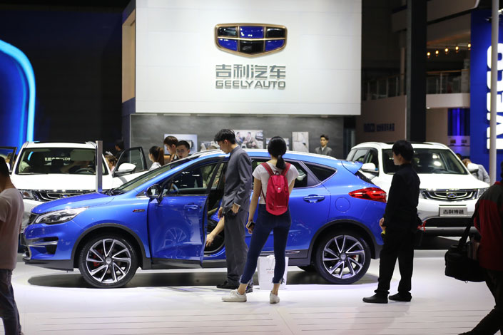 Geely show their new cars at the Shanghai Auto Show in April. The Chinese automaker acquired a major stake in Malaysia's Proton, and a controlling stake its sports car subsidiary Lotus. Photo: IC