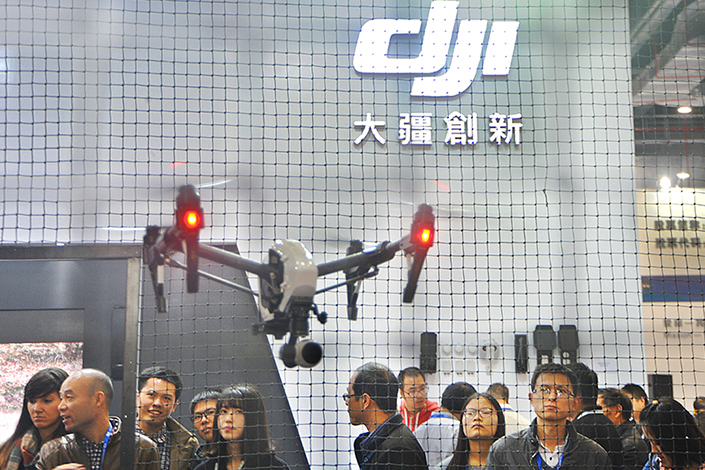 People look at drones produced by DJI in the 18th China International Industry exhibition in Shanghai, China, on Nov.1, 2016. Photo: Visual China