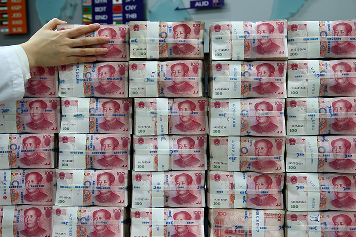 One-hundred yuan banknotes. The Chinese yuan extended its gaining streak against the U.S. dollar Thursday. Photo: Visual China