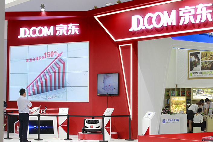 A JD.com booth at the 2017 Beijing International Service Trade Fair in Beijing, on May 31. The company is closing its Kumai platform for trading used goods. Photo: Visual China