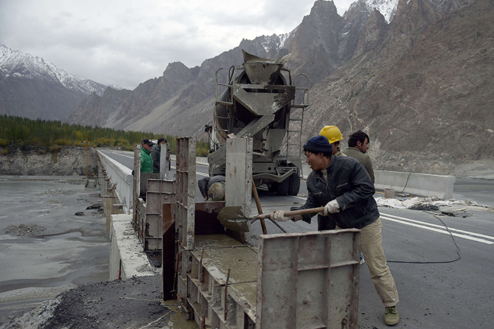 "The use of the yuan could be greatly boosted in countries involved in the ""Belt and Road"" program, a deputy governor of China's central bank said on Tuesday. Above, Chinese laborers work on the Karakoram Highway in Gulmit village in northern Pakistan in September 2015.  Photo: Visual China"