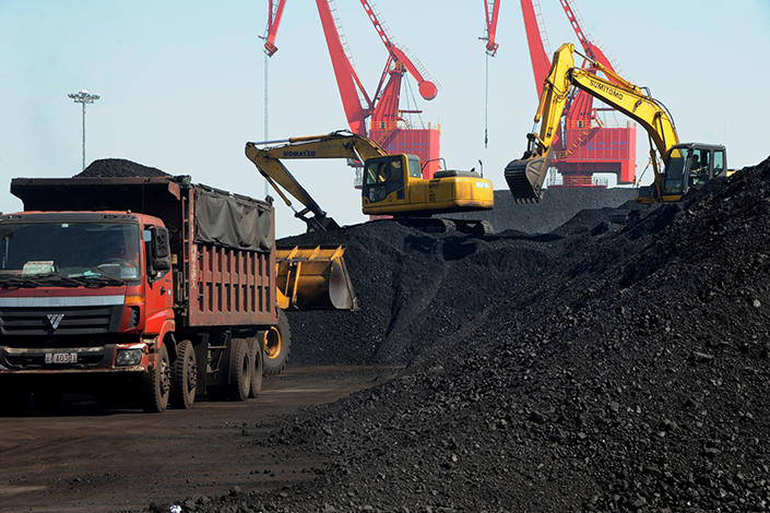 Increases in China's producer prices weakened for the third straight month in May. Above, a truck transports imported coal at the port in Lianyungang, Jiangsu province, in May 2014. Photo: IC