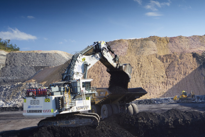 Yanzhou Coal said it will adjust its proposal to purchase a Rio Tinto subsidiary after Swiss-based Glencore outbid the original offer by over $100 million. Above, an excavator loads a truck with coal at the Rio Tinto coal mine in New South Wales, Australia. Photo: Yancoal Australia Ltd.