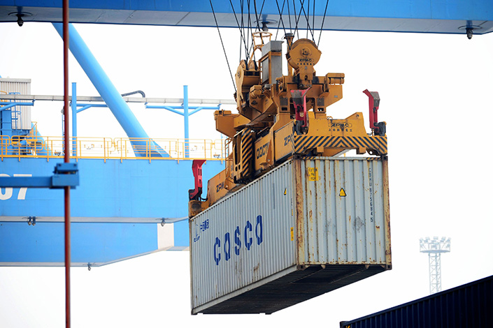 China COSCO Shipping Corp. Ltd. has agreed to take 15% ownership of Shanghai International Port Group Co. Ltd. from Shanghai Tong Sheng Investment Group Co. Ltd. for about 19 billion yuan ($2.8 billion). Photo: IC