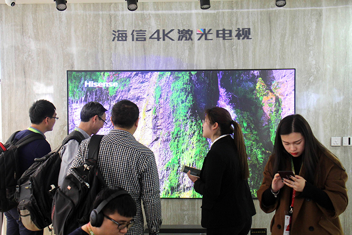 Sharp Corp. is seeking to pullout of a trademark contract in the U.S. with Chinese TV maker Hisense Co. Ltd. . Above, a Hisense laser television is displayed at the Appliance & Electronics World Expo in Shanghai on March 9. Photo: Visual China