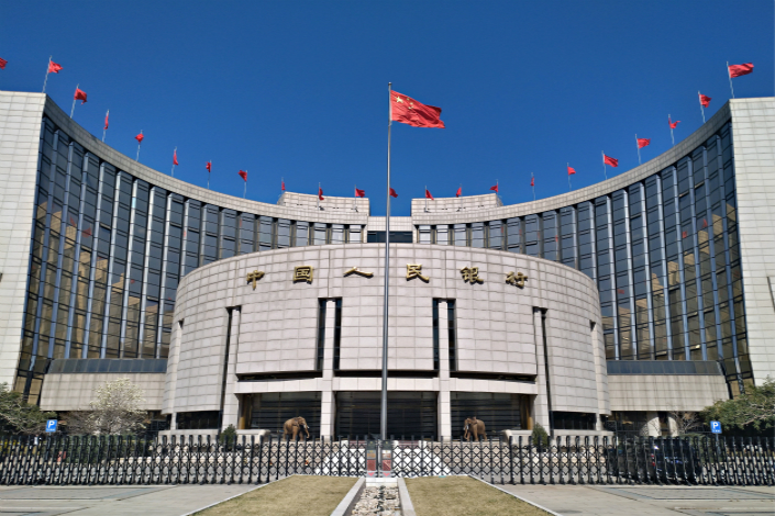 As part of the country's ongoing campaign to slim down its bloated financial system and rein in hidden and possibly toxic debts, the People's Bank of China decided early this year that it would take the lead and coordinate with often-territorial regulators, forcing them to work together. Photo: IC