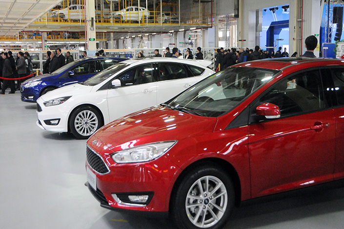 Ford Motor Co. announced it will transfer partial production of its Focus models to China. Above, Focus cars are displayed in Harbin, Heilongjiang province, on Feb. 22. Photo: IC