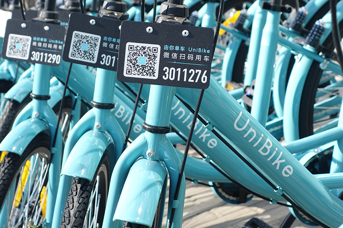 Beijing Mobike Technology Co. will acquire Xiamen-based UniBike in the near future, portal Tencent reported, citing an unnamed source.  Photo: IC