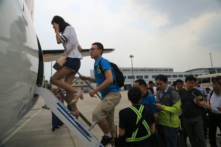 China's State Council wants to build over 500 general aviation airports across the country, but local governments have plans for far more.  Above, passengers board a Xian MA60 aircraft in the northeastern province of Liaoning on June 12, 2017. Photo: IC