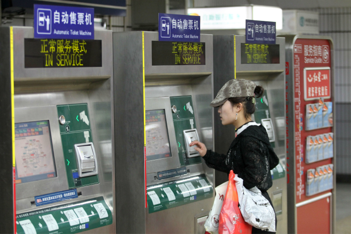 Beijing's subway authorities are urging passengers to dispense with their transportation cards and committ to paying for fares with their smartphones. Photo: Visual China