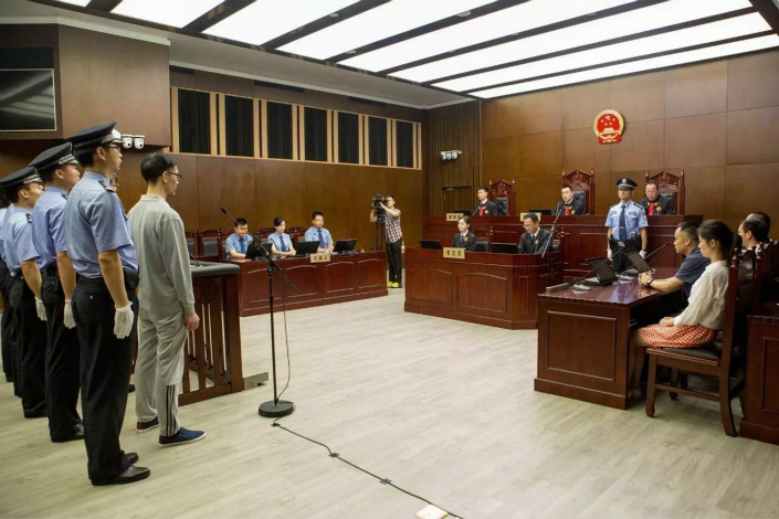 At a sentencing hearing on Friday in Shanghai, the Shanghai No. 1 Intermediate People's Court fined Yishidun International Trade Co. 300 million yuan ($43.9 million) and ordered it to hand over 389 million yuan in illegal gains made from high-frequency trading on China's index futures. Photo: Shanghai No. 1 Intermediate People's Court