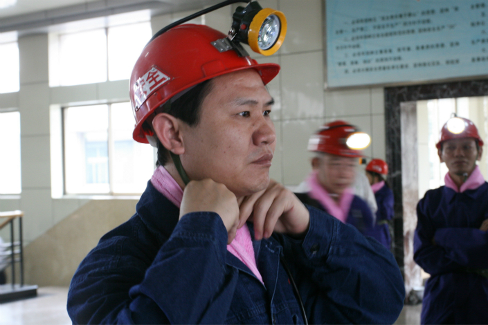Yanzhou Coal Mining Co. Ltd. has apparently won a bidding war for Coal & Allied Industries Ltd., a Rio Tinto Group subsidiary in Australia. Above, a miner goes through a security check before descending into a mine in Yanzhou, Shandong province, in May 2007.  Photo: Visual China