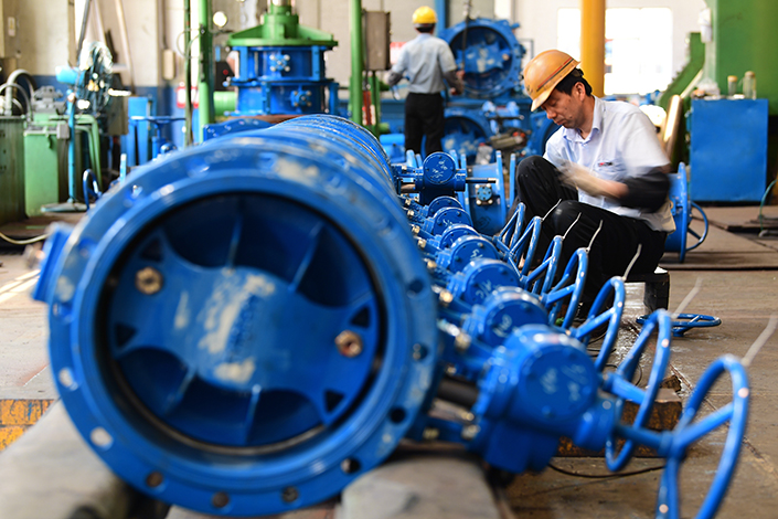 China's manufacturing PMI rose to 51.7 in June, its second-highest monthly reading of 2017. Above, a worker at a valve manufacturer assembles a flange butterfly valve on May 26 in Jiangsu province. Photo: Visual China
