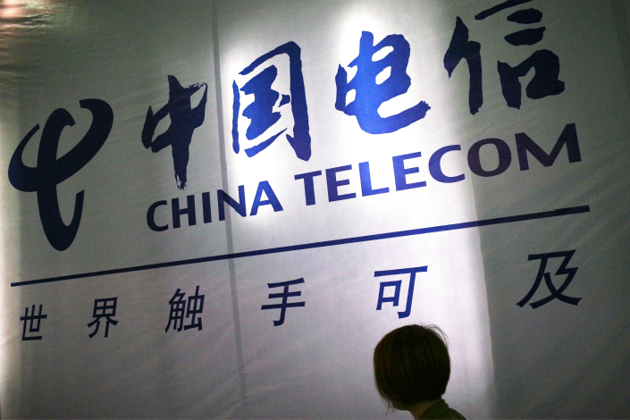 A China Telecom stand at an exhibition in Jinan. A former vice president of the company is being probed for corruption after allegedly accepting bribes from two firms seeking to do business with the wireless carrier. Photo: IC