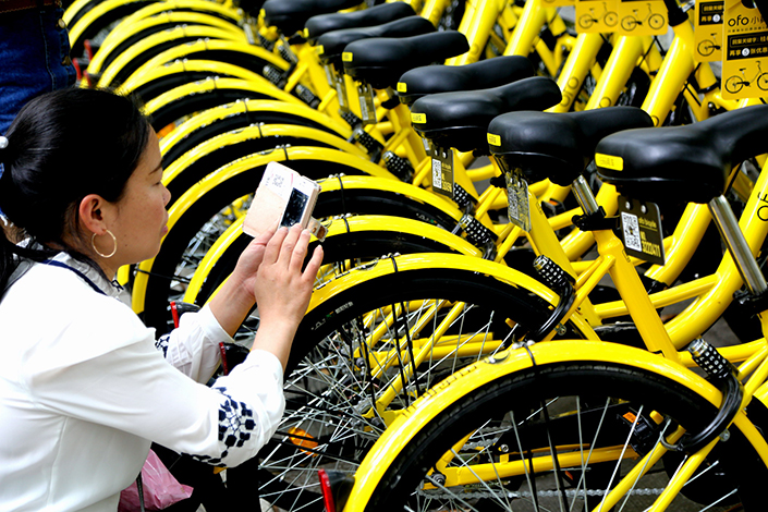 Shared-bike operator Ofo Inc., known for its trademark yellow two-wheelers, said it has raised $700 million in new funding, led by Alibaba Group Holding Ltd. and Russia's DST. Photo: Visual China