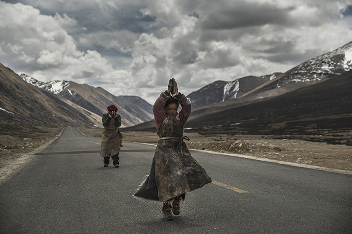 """A scene from the low-budget docudrama """"Paths to the Soul,"""" which follows a group of pilgrims on a 1,200-mile trek from their village to Mt. Kailash in Tibet. In an act of Buddhist devotion, the pilgrims make the journey while prostrate. Photo: IC"""