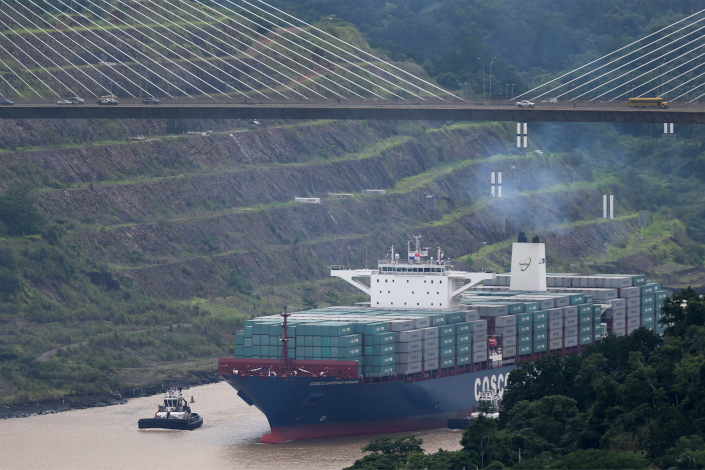Chinese Shipping giant COSCO has reported it will return to profitability this year. Above, the Cosco Shipping Panama passes through the Agua Clara lock of the Panama Canal in June 2016. Photo: IC