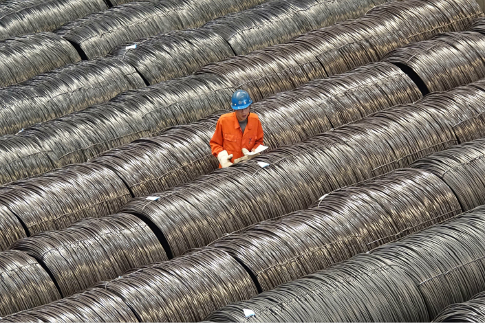 Debt-strapped Dongbei Special Steel Group Co. Ltd., together with its subsidiaries, has defaulted on 7.2 billion yuan in debt since March 2016. Above, an employee of Dongbei Special checks product markings for steel alloy on May 15 in Dalian, Liaoning province. Photo: Visual China