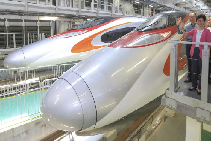 Hong Kong Chief Executive Carrie Lam on Sunday inspects a high-speed train that will be one of the nine operating on the high-speed rail system linking Hong Kong to the Chinese mainland. The system is expected to be up and running in about a year. Photo: IC