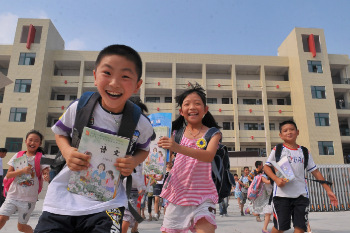 The number of primary schools and middle schools in China has fallen 18.5% between 2012 and 2016, even though the population of school-age children is on the rise. Photo: Visual China