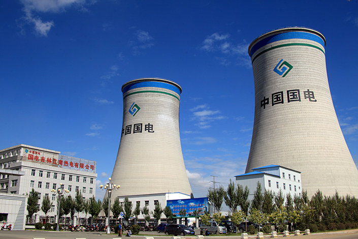 China plans to consolidate the number of companies supervised by the State-Owned Assets Supervision and Administration Commission from 101 to about 80. Above, two China Guodian Corp. towers are seen in Jilin city in September 2013. Photo: Visual China