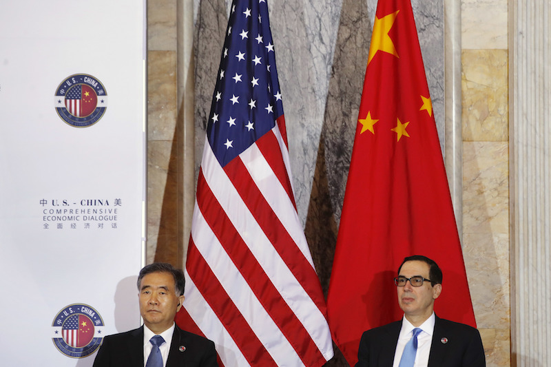Chinese Vice Premier Wang Yang, left, and U.S. Treasury Secretary Steven Mnuchin, attend the U.S.-China Comprehensive Economic Dialogue on Wednesday at the Treasury Department in Washington. Photo: IC.