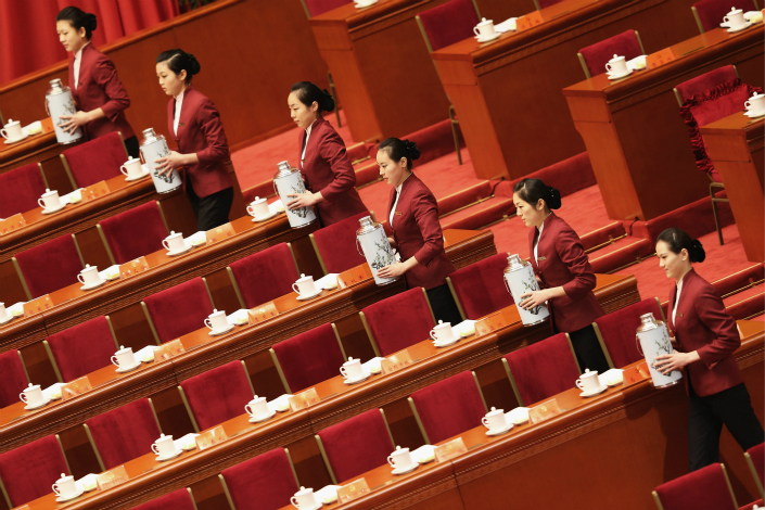 A total of 44 delegates from China's finance sector will attend this autumn's 19th Party Congress. Above, attendants stand ready to serve tea before the 18th Communist Party Congress at the Great Hall of the People in Beijing in November 2012. Photo: Visual China
