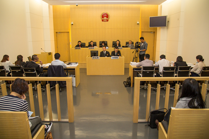 Shanghai No. 1 Intermediate People's Court hears a case involving an alleged stock trading fraud on Sept. 16, 2015. The court has witnessed a surge in securities-related lawsuits in the past three years. Photo: Shanghai High People's Court