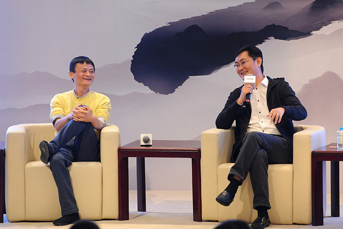 Alibaba Group Holding Ltd. and Tencent Holdings Ltd. are new additions to the Fortune Global 500, a list of the world's companies with the highest revenues. Above, Alibaba CEO Jack Ma (left) talks with Tencent CEO Pony Ma at the Internet Financial Industry Forum in Shanghai in November 2013. Photo: IC