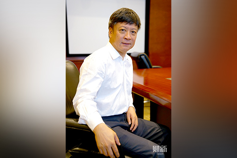 Sunac halted land purchases and set a goal of slashing its debt ratio by almost three-quarters. Above: Sunac Chairman Sun Hongbin. Photo: Caixin/Yang Yifan.