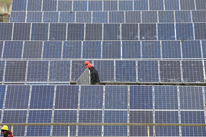 Solar-panel industry sources are predicting that India will launch an investigation into accusations that China is dumping the product in the country. Above, workers install solar panels in Yueqing, Zhejiang province, on March 29. Photo: Visual China