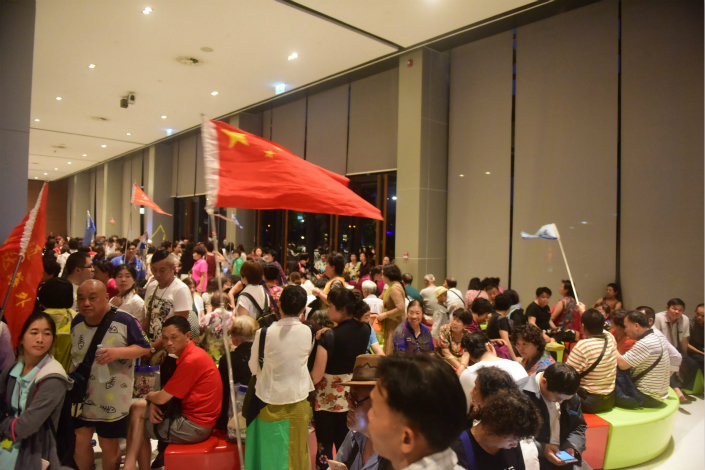 Some tour guides in China sell package tours for as little as 40 yuan ($5.92) per person, only to then pressure their clients into buying things at stores where they receive a commission. Chinese tourists shop at the King Power duty-free store in Bangkok on March 13. Photo: Visual China