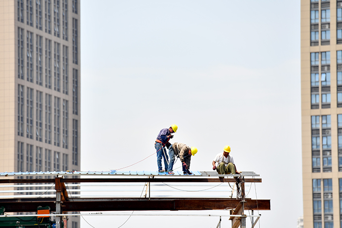 The Chinese Politburo emphasized at its most recent meeting that the government's proactive fiscal policy, and prudent and neutral monetary policy, will be maintained, suggesting that the country's top leaders are focusing on financial reform rather than growth. Above, workers are seen at a construction site in Zhengzhou, Henan province, on May 19. Photo: Visual China