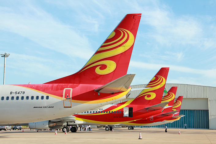 HNA's failed tie-up with a U.S. satellite services provider comes at a time when big global Chinese buyers are under pressure from Beijing to scale back their huge volume of overseas investments. Above, four airplanes belonging to HNA subsidiary Hainan Airlines await passengers in Hainan province in September 2015. Photo: Visual China