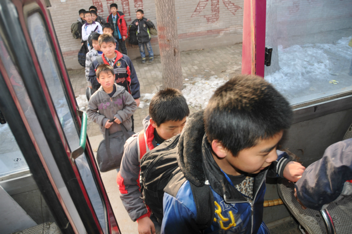 The deaths of four Hebei province preschoolers within two weeks after being locked in sweltering school buses has provoked outrage nationwide. Above, students of Qiaodong No.3 School board a school bus after class in Xingtai, Hebei province, in December 2011. Photo: Visual China