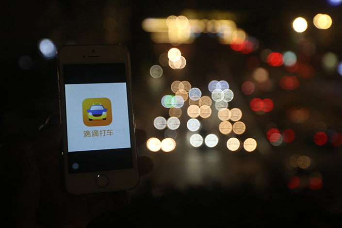 Ride-hailing service Didi Chuxing, whose app is seen above, could be penalized for moving ahead with its union with Uber last year before submitting a premerger application as required by Chinese law. Photo: Visual China