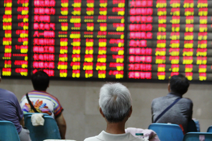 The China Securities Regulatory Commission said in June 2016 it would issue tighter rules to curb shell-company trading, but it has yet to announce new rules although it has heightened scrutiny over such deals. Above, a stock trader watches prices at a stock market in Najing, Jiangsu province, on Wednesday. Photo: Visual China