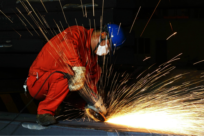 Major steel manufacturers earned a collective 40.3 billion yuan in profits in the five months through May, well above what they earned for all of 2016. Above, a worker polishes a steel mold at Dalian Special Steel Co. on July 10. Photo: Visual China
