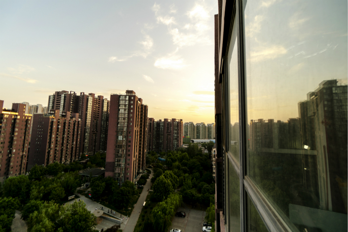 New-home sales measured by floor space dropped 46% year-on-year in July in the first-tier cities — Beijing, Shanghai, Guangzhou and Shenzhen. Above, residential buildings are seen in Beijing's Tongzhou district in May. Photo: Visual China